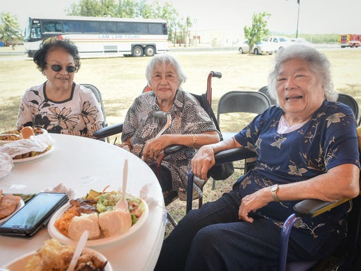From right, Julia Duenas, 82, and Lucy Duenas, 91,