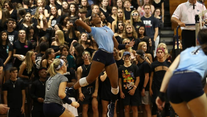 Maclay's Jewel Strawberry leaps to spike the ball against Chiles at Chiles High School Thursday, Aug. 24, 2017.