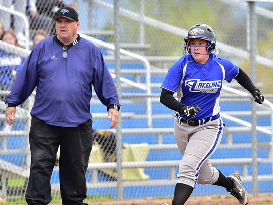 Lakeland's Lexie Shoup (right) looks to go home in front of coach Joe Alsup.