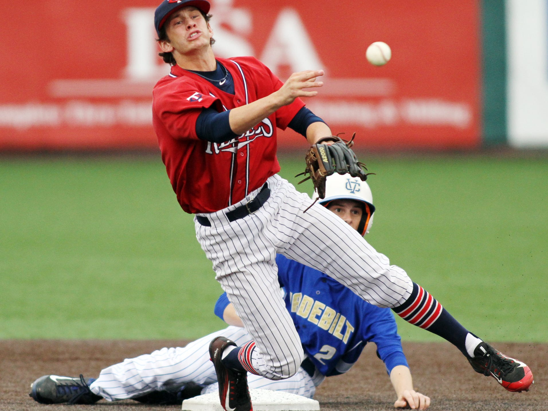 Teurlings Catholic shortstop Josh Taylor (3) attempts to complete a double play during the Rebels' 8-1 win over Vandebilt Catholic on Tuesday at Tigue Moore Field.