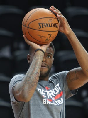 Pistons swingman Reggie Bullock warms up before the game against the Pacers Tuesday at The Plalce of Auburn Hills.
