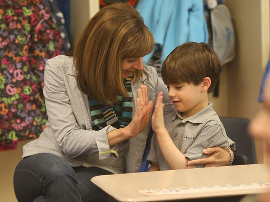 First-grader Tyler Kyle (cq) gets a high-five from