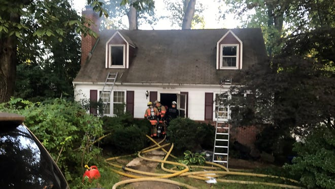 When firefighters in Bethesda, Maryland, extinguished a blaze Sept. 10, 2017, in this Cape Cod-style house, they found hoarding, hazardous materials, tunnels underneath the site and contractor Askia Khafra's body.