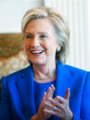 Democratic presidential hopeful, former Secretary of State Hillary Rodham Clinton, smiles during a campaign house party, Saturday, June 13, 2015 in Sioux City, Iowa.