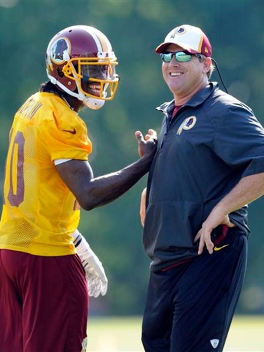 NICK WASS -- THE ASSOCIATED PRESS  Washington Redskins' quarterback Robert Griffin III is over a year removed from ACL surgery and could be in for a bounce-back fantasy season under new head coach Jay Gruden.
