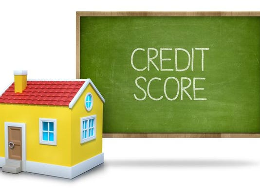 Credit score text on green blackboard with house