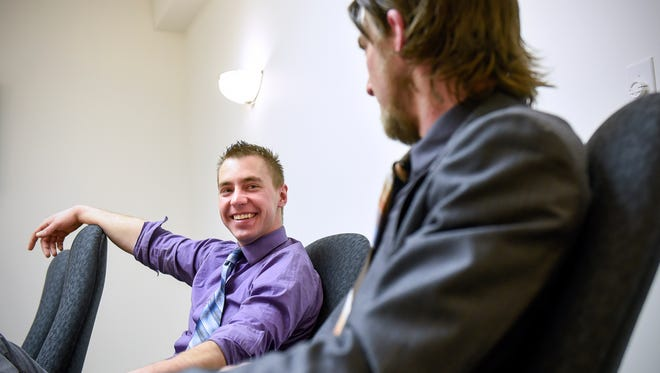 Jake Friedrichs, left, smiles while talking with Adam Studer about the start of Ten Twenty Advertising during an interview Thursday, Feb. 9, in St. Cloud.
