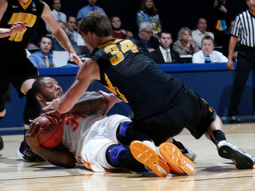 Tennessee Volunteers forward Jeronne Maymon (34) battles for the ball with Iowa Hawkeyes center Adam Woodbury (34) in the first half of a college basketball game during the first round of the 2014 NCAA Tournament at UD Arena.