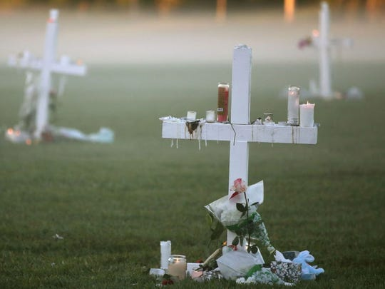 Makeshift crosses for the victims were seen before