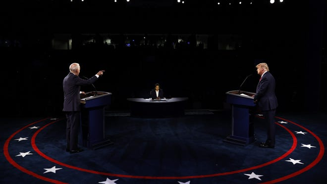 President Donald Trump and Democratic presidential candidate former Vice President Joe Biden participate in the final presidential debate at Belmont University, Thursday, Oct. 22, 2020, in Nashville, Tenn.