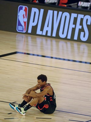 Toronto Raptors guard Kyle Lowry (7) sits on the court after s forward OG Anunoby (3, not pictured) made the game winning 3-point basket to defeat the Boston Celtics in game three of the second round of the 2020 NBA Playoffs at ESPN Wide World of Sports Complex.
