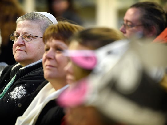 Darlene Noll, in glasses, watches from the spectators