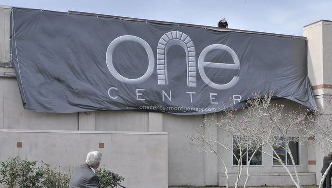 Montgomery Mayor Todd Strange stands in front of the new One Center sign. The old Montgomery Mall site was rebranded as One Center on Tuesday.