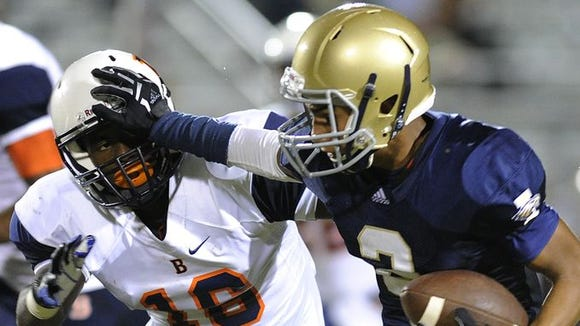 Independence's Nate Johnson blocks Blackman's Blake Taylor while carrying the ball