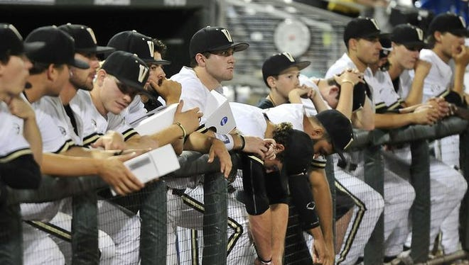 Vanderbilt players are dejected in the dugout after a 4-2 loss to Virginia on Wednesday.