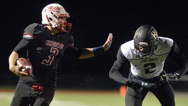 Hilton senior Dillon Philmon, left, scored five touchdowns and set a single-game school-record with 349 rushing yards in a 2015 win over Rush-Henrietta.