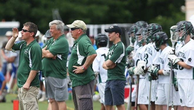 Pleasantville coach Chris Kear (left) grew up learning from his father, Bob (third from left), and passing along what he knew to younger brothers, Casey and Tucker.