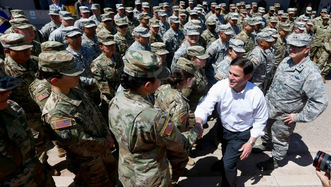 Arizona Gov. Doug Ducey  meets Arizona National Guard soldiers in Phoenix on April 9, 2018, before their deployment to the border.