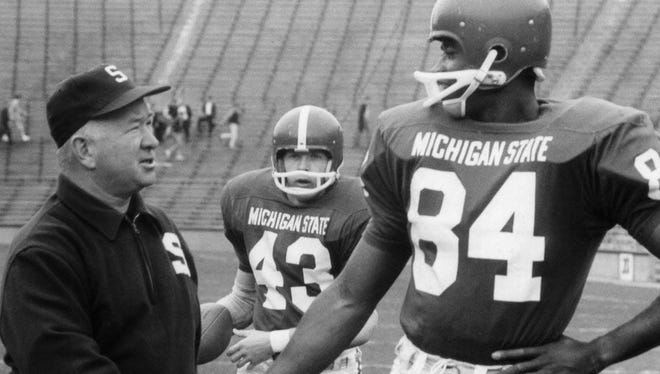 Gene Washington, pictured with Duffy Daugherty, helped MSU win national championships in 1965 and 1966.
