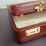 Open leather briefcase, , (Close-up)
