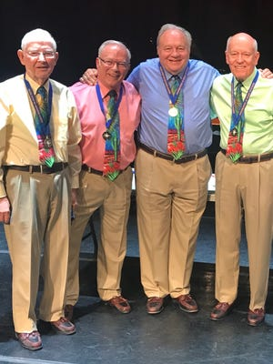 Las Cruces' Cactus Chords Barbershop Quartet, John Phillips, tenor; Larry Courter, lead; Steve Litts, bass; and Scott Russell, baritone, are shown receiving their third consecutive first-place medals in the New Mexico State Senior Olympics Seniors Got Talent Show, Group Vocals, Age 70+.