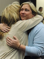 Paula Lowe hugs her daughter Lindsey Lowe before the jury returned a verdict of guilty during Lindsey's murder trial March 19, 2013, in Gallatin.