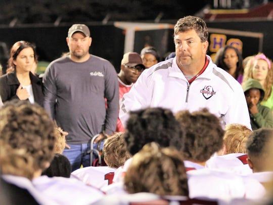 Crockett County coach Kevin Ward talks to his team