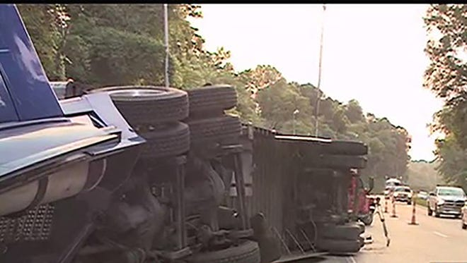 An 18-wheeler overturned, spilling its load of chicken onto Interstate 20