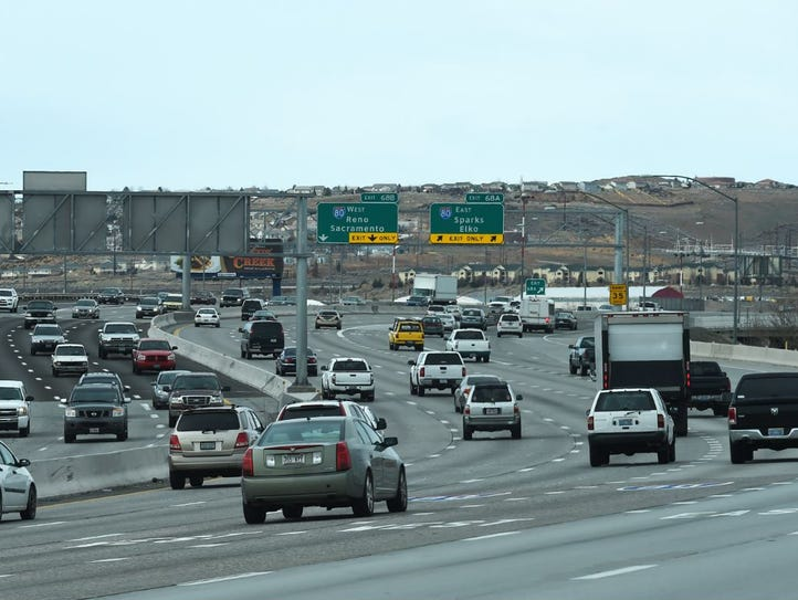 Northbound traffic approaches the busy Spaghetti Bowl