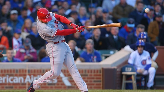 Cincinnati Reds shortstop Zack Cozart (2) hits a single during the first inning against the Chicago Cubs at Wrigley Field on Monday.