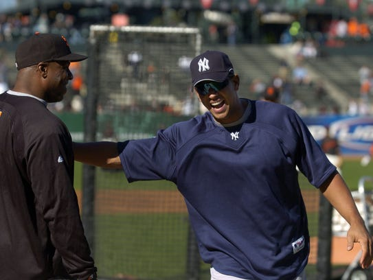 Barry Bonds and Alex Rodriguez, shown here before a