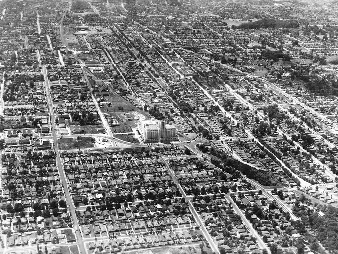An aerial photo looking west past the Sears tower shows