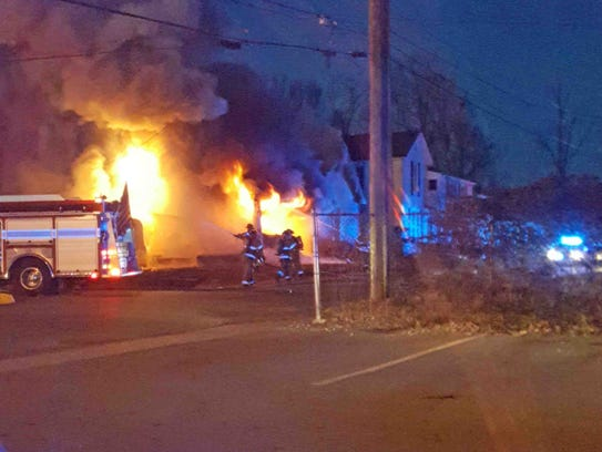 Clarksville Police officers rescue a man from a burning