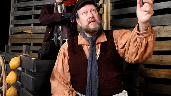 """Tevye (played by Dave Conley, right) muses on his fortunes while the fiddler (David Watts) looks on. """"Fiddler on the Roof,"""" the popular musical about balancing tradition in the face of changing times, runs at the Barn Theatre in Montville tonight through December 2."""