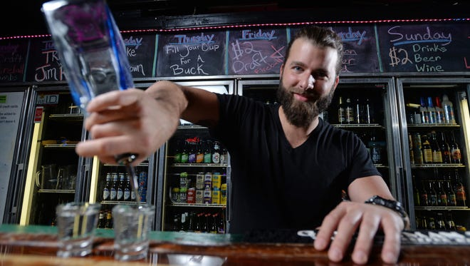 It doesn't always take a shot of tequila for people to open up to Trey Carter, owner and bartender at Strange Brew.