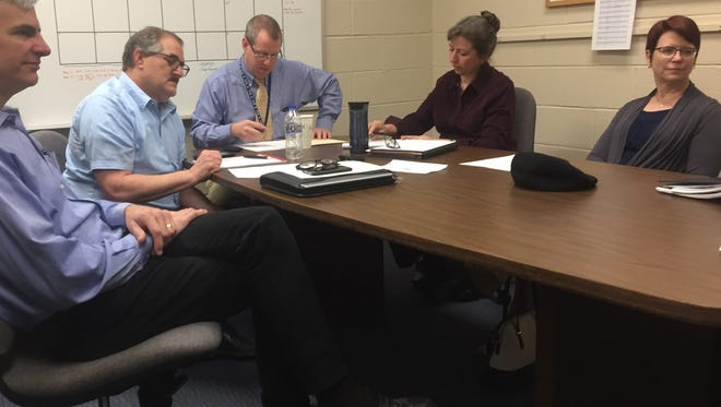 Granville Board of Education members and administrators met early the following morning to discuss cuts, possible new fees, after the May 8 income tax defeat. From left, Thomas Miller, Michael Sobul, Jeff Brown, Amy Deeds and Jennifer Cornman.