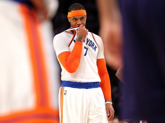 New York Knicks small forward Carmelo Anthony (7) reacts after missing two of three free throws during the third quarter against the Charlotte Hornets at Madison Square Garden. Brad Penner-USA TODAY Sports