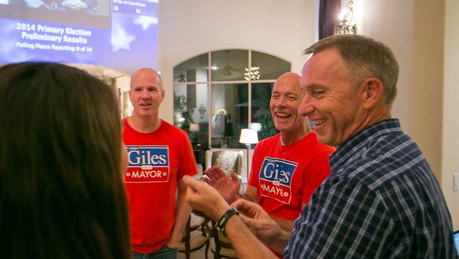 Mesa mayoral candidate John Giles watches election results with supporters at his home in Mesa on Aug. 26, 2014.