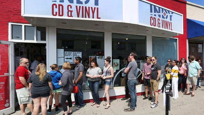 Music fans wait to enter Indy CD & Vinyl during the 2015 edition of Record Store Day.