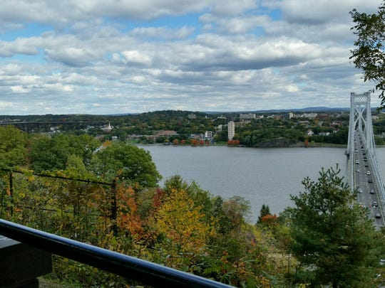 The scenic blue trail overlooks the Hudson River with the Walkway Over the Hudson and the Mid-Hudson Bridge.