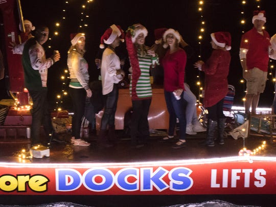 """A huge pile driving barge captained by Tom Moore took """"most entertaining"""" in the Isles of Capri 13th Annual Christmas Boat Parade on Dec. 10."""