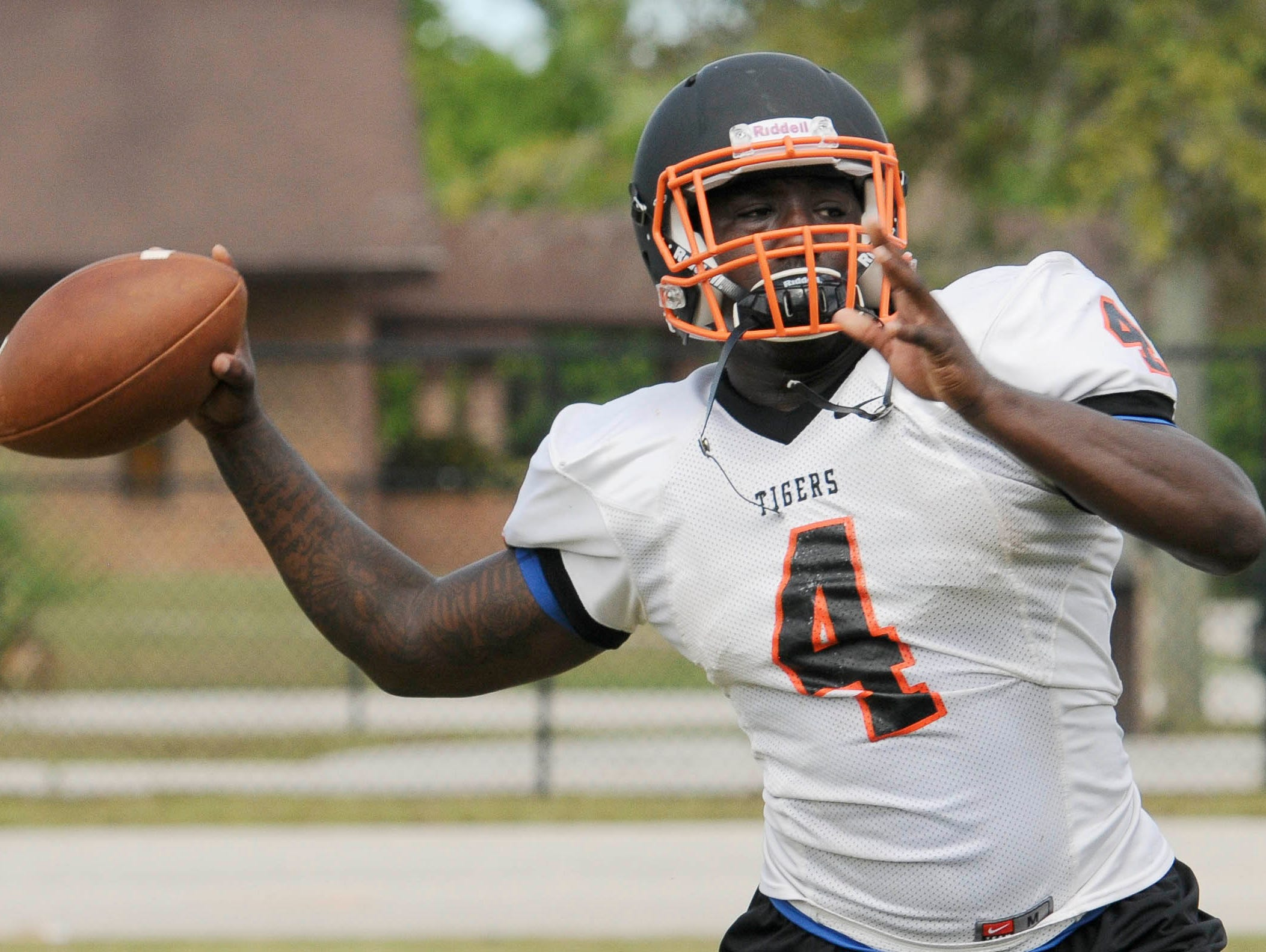 Cocoa High School QB Bruce Judson throws to an open receiver during practice Tuesday afternoon.
