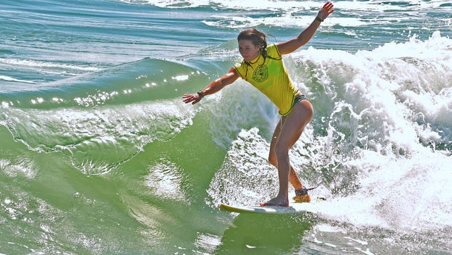 Nicole Golden in a shortboard heat. Sunday at the Salty Sweet Women's Pro-Am Surf Contest hosted by the Cocoa Beach Pier. The competition included kids and adults in several categories.
