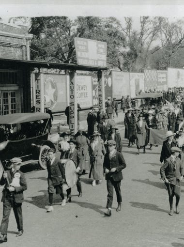 The Liberty Loan Drive parade in 1918 was held to sell bonds to support the first World War. Pictured above shows Palafox Street with Christ Church in the background and the parade traveling southbound towards Garden Street.