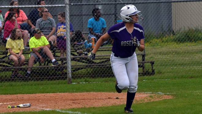 Rosepine's Lauryn McMahon (3) watches the ball sail out of the park in Rosepine's game against Rapides.