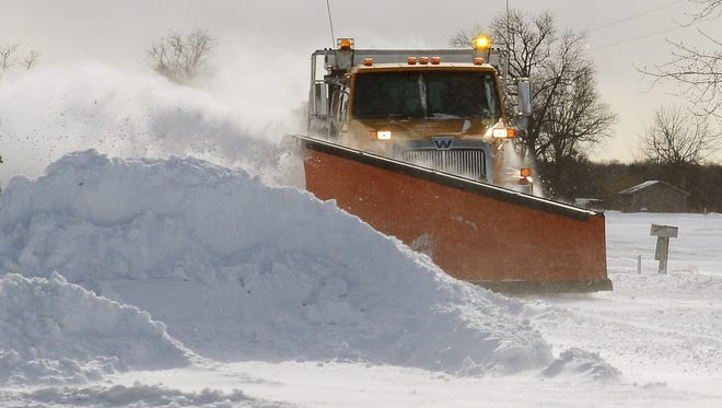 A St. Clair County Road Commission plow works during the winter of 2014.