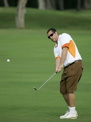 """Actor Adam Sandler chips the ball onto the sixth green of Waialae Country Club during the pro-am of the Sony Open PGA Tour golf event in Honolulu on Jan. 10, 2007. Sandler sure wishes he could hit the ball as far as his former movie character """"Happy Gilmore."""""""