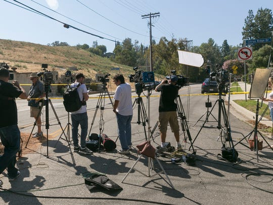 The media gather outside Chris Brown's house in Los