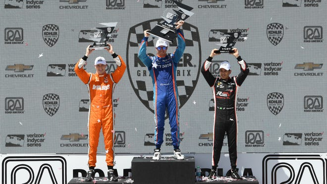 Winner Scott Dixon is flanked by runner-up Josef Newgarden (left) and third-place finisher Helio Castroneves after the 2017 Kohler Grand Prix at Road America.