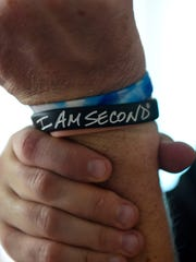 Tim Shaw wears wristbands as reminders of his faith.